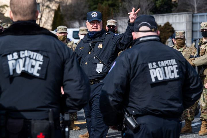 U.S. Capitol Police and National Guard troops conduct a security briefing on Independence Avenue on March 4, 2021.