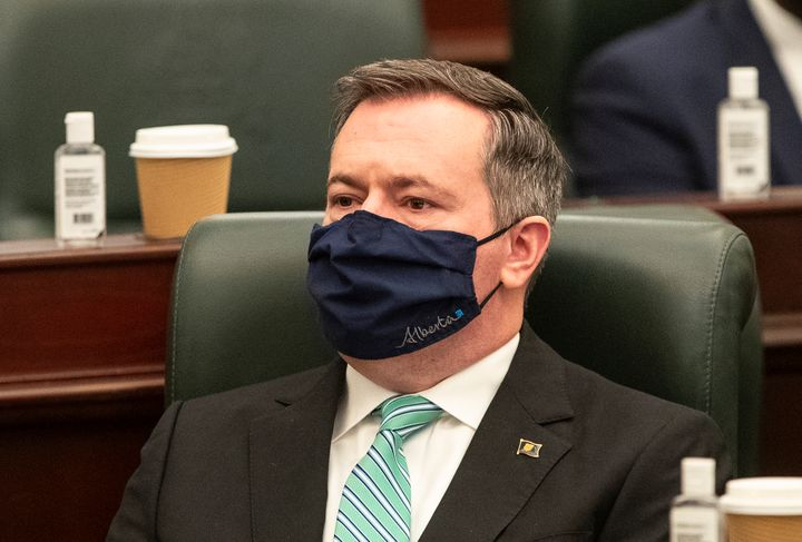Alberta Premier Jason Kenney listens as the 2021 budget is delivered in Edmonton Alta, on Feb. 25, 2021.