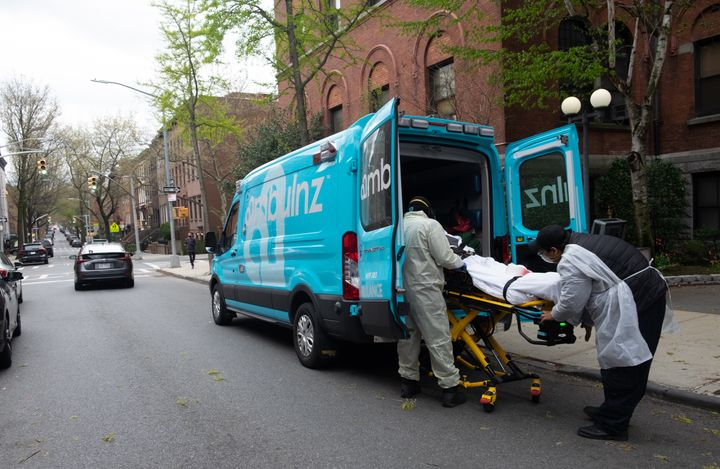 Ambulance workers pick up an elderly man in March 2020 from Cobble Hill Health Center, one of the nursing homes in New York C