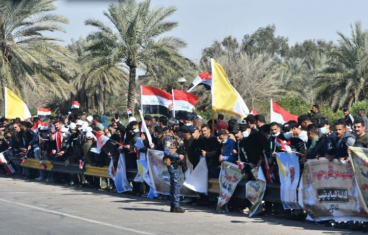 Iraqis line up along the road leading to Baghdad airport as they welcome the pontiff upon his arrival.