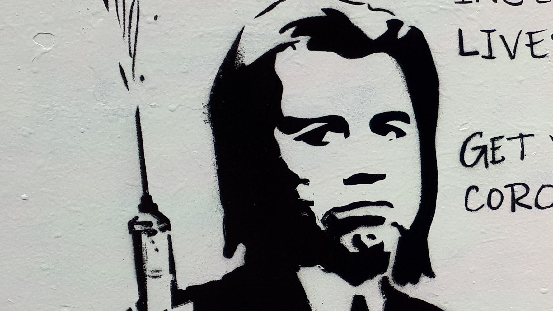 Street Artist Goes Full 'Pulp Fiction' To Encourage COVID-19 Vaccinations
