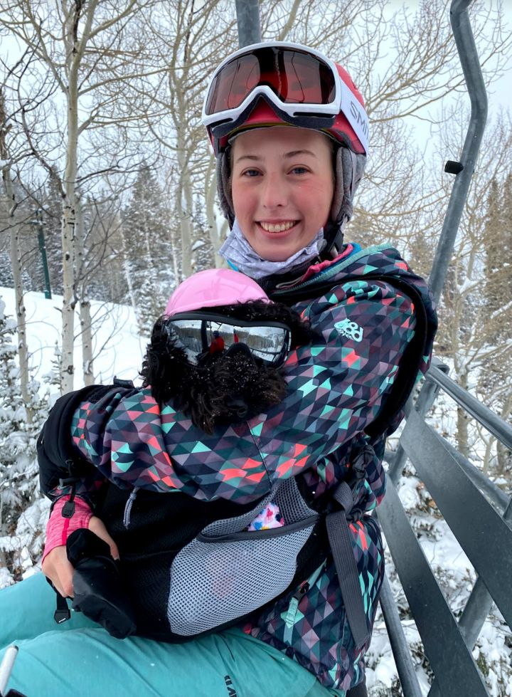 The author riding a chairlift with her service animal at the Deer Valley Resort on Jan. 23.