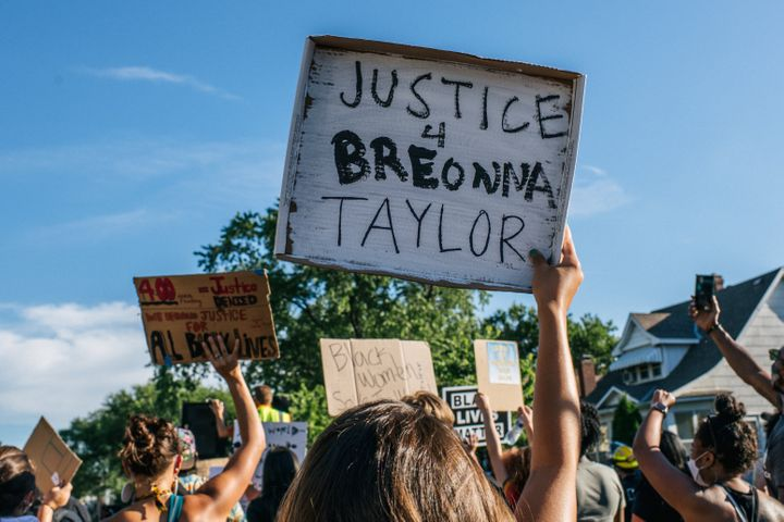People march in the streets during a demonstration on June 26, 2020 in Minneapolis honoring Breonna Taylor, who was shot and