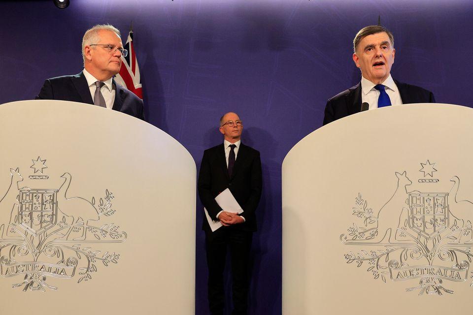 Australian prime minister Scott Morrison (left) is joined by Dr Brendan Murphy, secretary of the department...
