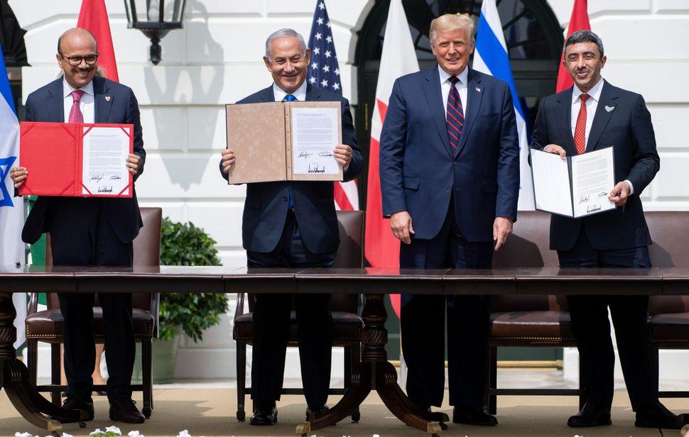 From left to right, Bahrain Foreign Minister Abdullatif al-Zayani, Israeli Prime Minister Benjamin Netanyahu, U.S. President