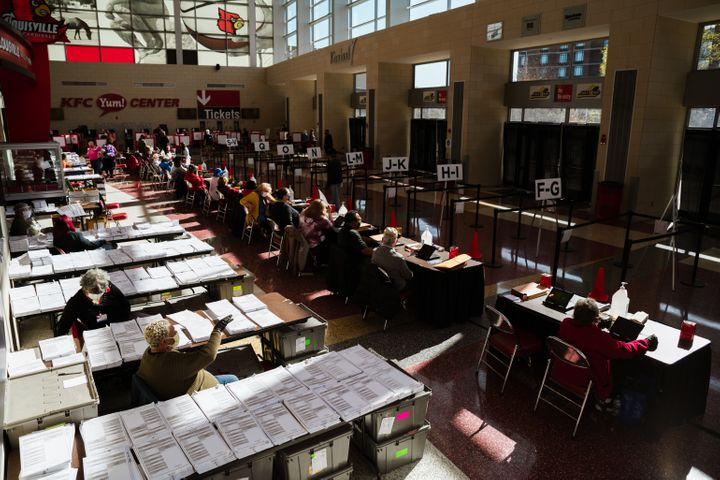 Election officials wait for voters in the KFC YUM! Center on Nov. 3 in Louisville. The 2020 election was the first time many