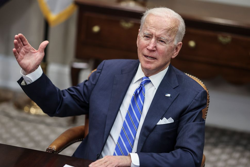 Biden speaks during a virtual call in the Roosevelt Room of the White House, March 4, in Washington, D.C.