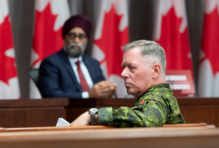 National Defence Minister Harjit Sajjan and Chief of Defence Staff Jonathan Vance listen to a question during a news conference on June 26, 2020 in Ottawa.