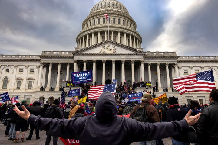 A mob of unambiguous Trump supporters stands outside the Capitol on Jan. 6.