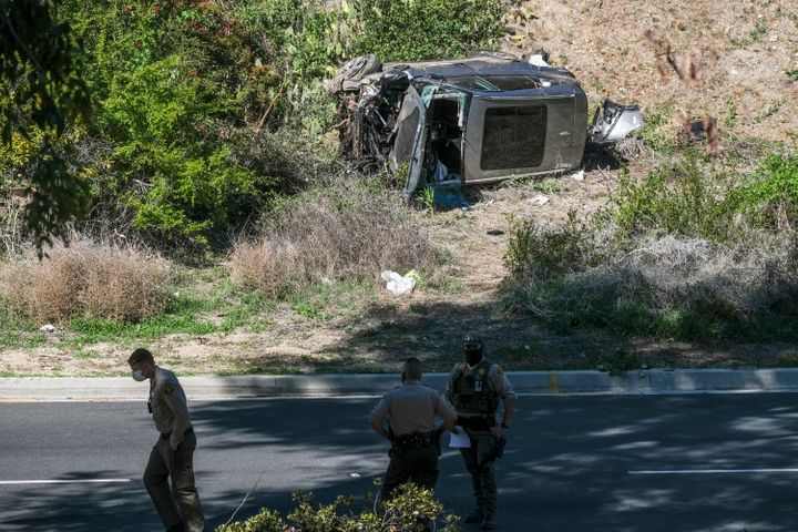 A vehicle rests on its side after a rollover accident involving golfer Tiger Woods on Feb. 23 along a road in the Rancho Palo