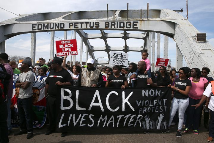 Thousands of people walk across the Edmund Pettus Bridge during the 50th anniversary on March 8, 2015, in Selma, Alabama. Thi