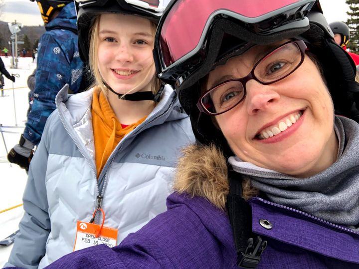 The author and her daughter, Abigail, skiing in February 2020, just weeks before the author became ill with COVID-19.