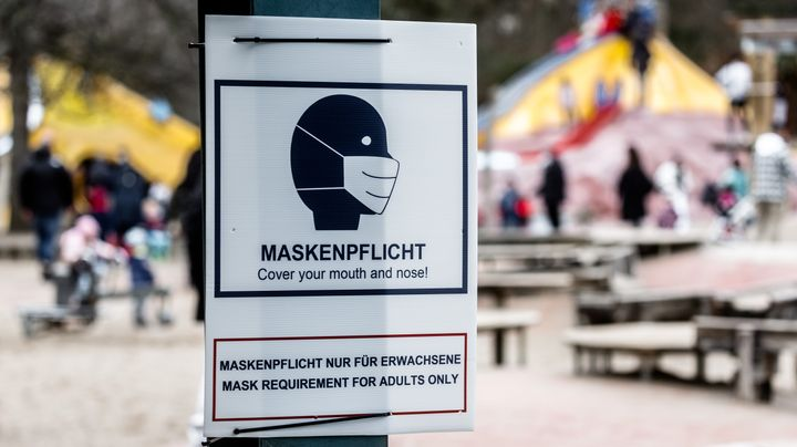 """A sign that says """"mask requirement"""" hangs at the entrance to a public playground in Hamburg, Germany, in February. In certain"""