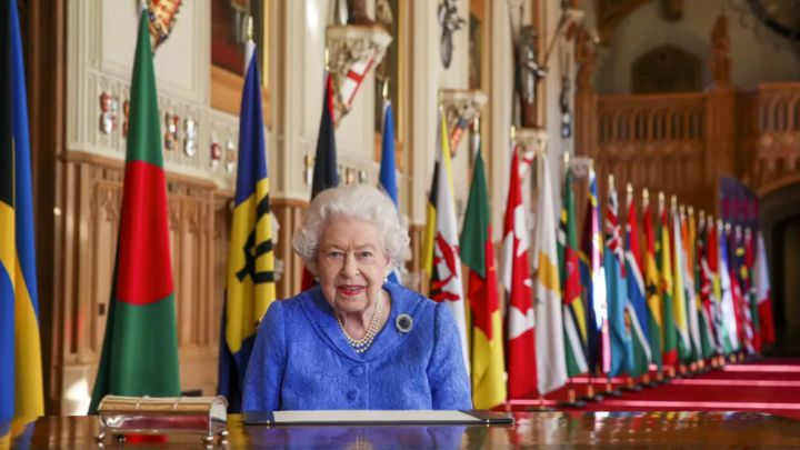 A smiling Queen pictured against a backdrop of flags for Commonwealth Day on March 7