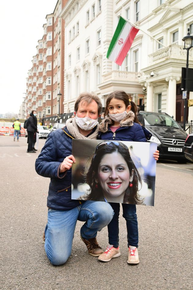 Richard Ratcliffe, the husband of Nazanin Zaghari-Ratcliffe, with his daughter Gabriella during a protest...