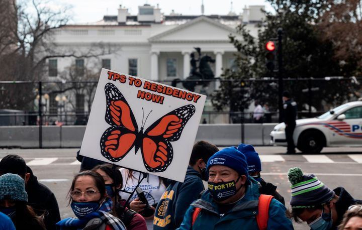 Activists and citizens with temporary protected status (TPS) march along 16th Street toward the White House in a call for Con
