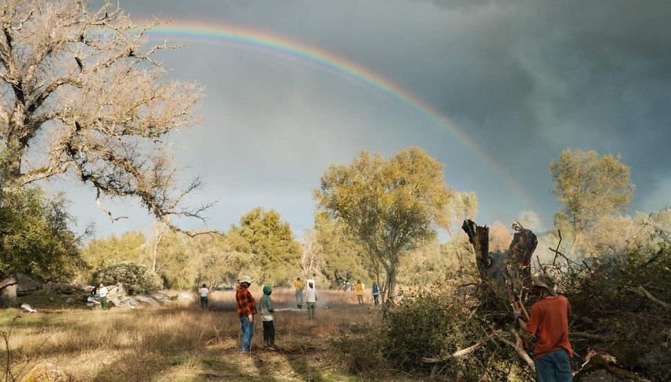 Once the rain stops, a rainbow forms over the property in Mariposa, California, as volunteers finish up the first day of work