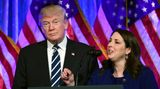 President Donald Trump listens as Republican National Committee chair Ronna Romney McDaniel speaks at a Dec. 2, 2017, fundraiser in New York City.