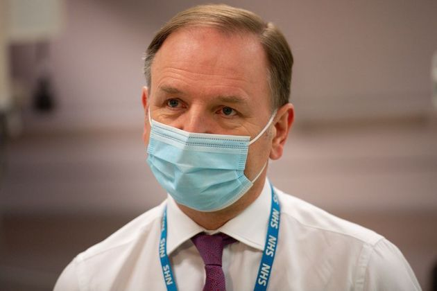 Sir Simon Stevens gestures during a visit to a Covid-19 vaccination clinic at University Hospital Coventry...