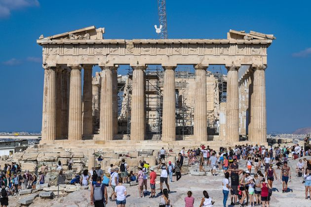 Overcrowded with thousands of tourists and visitors during the morning in Parthenon, Acropolis in Athens,...