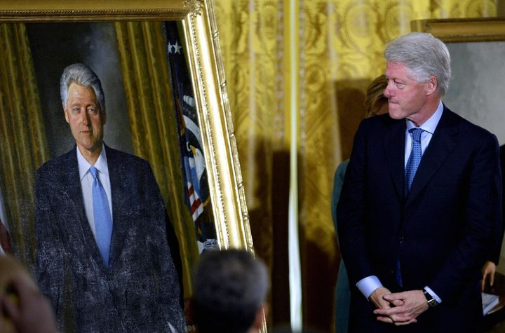 Former President Bill Clinton views his official White House portrait before it was hung in the grand foyer during the unveil