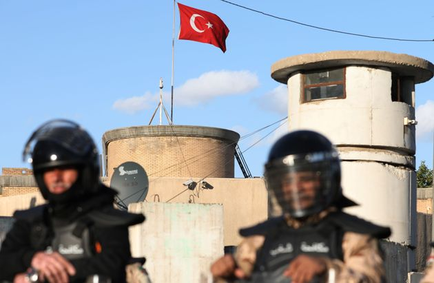 Iraqi riot police protect the Turkish embassy in Baghdad on February 18, 2021 after calls on social media...