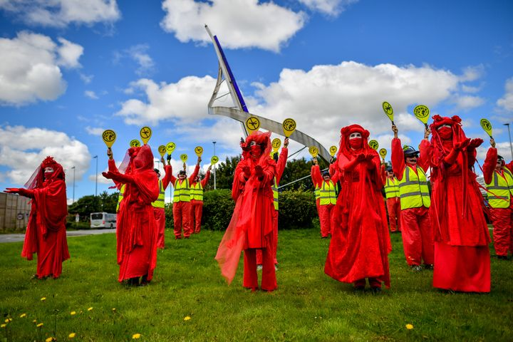 The Red Rebels from Extinction Rebellion protest against the airport's expansion in August, 2020.