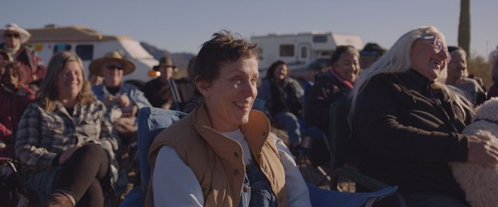 "Frances McDormand at the Rubber Tramp Rendezvous in ""Nomadland."""