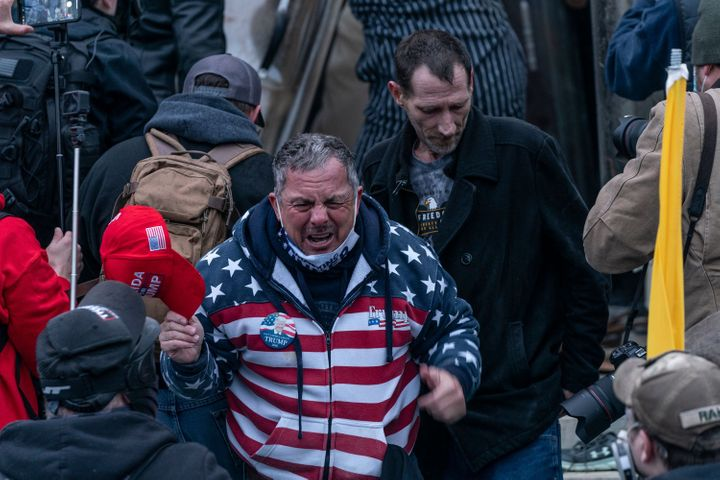 HuffPost identified Robert Scott Palmer (center) as a member of the pro-Trump crowd that stormed the U.S. Capitol on Jan. 6.