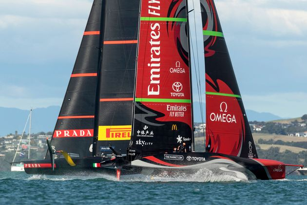 Luna Rossa Prada Pirelli (L) competes against Emirates Team New Zealand during race three on day two...