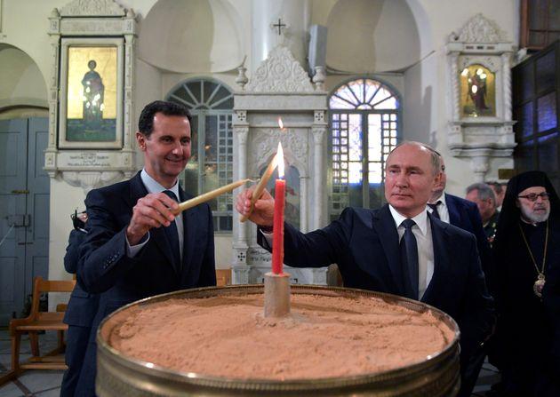 Vladimir Putin y Bachar al Assad, en la Catedral Ortodoxa de Damasco, en enero de