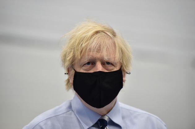Boris Johnson during a visit to the Lakeland Forum vaccination centre in Enniskillen, Northern
