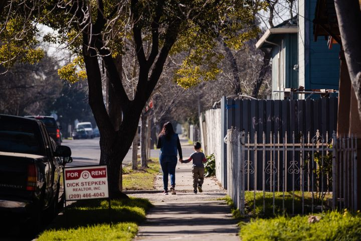 A mother and son walk through one of the neighborhoods of Stockton, California on Feb. 7, 2020. The city recently finished a two year basic income trial.