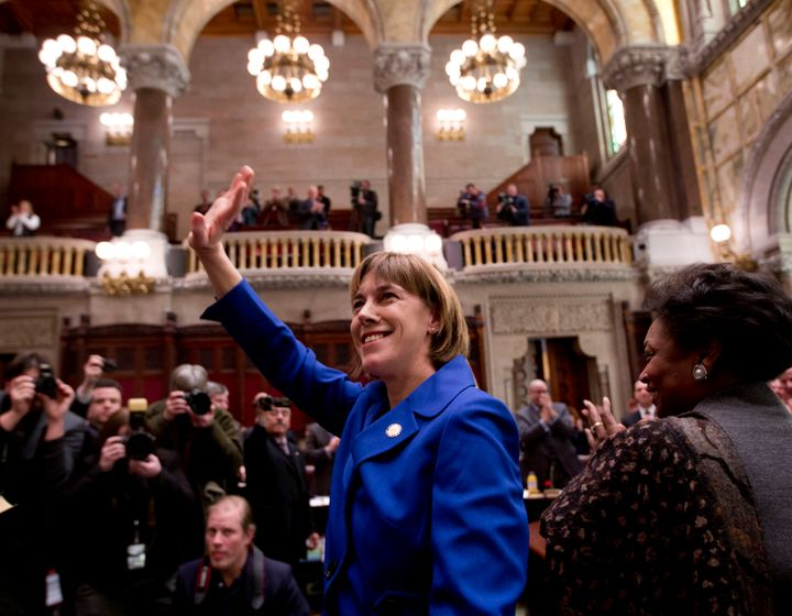 New York state Sen. Cecilia Tkaczyk (D) waves to the gallery after being sworn in to office at the Capitol in Albanyon
