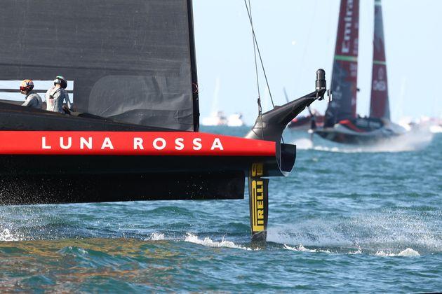 Luna Rossa Prada Pirelli (L) competes against Emirates Team New Zealand during race six on day three...