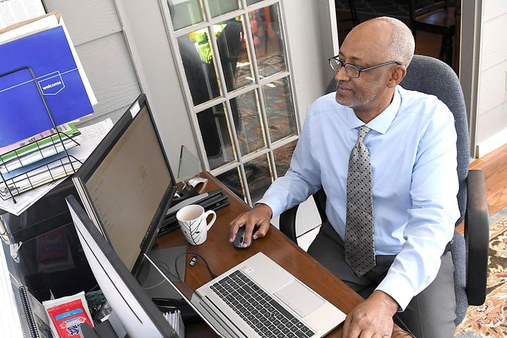 Abdi Sabrie works in his home office Thursday, March 11, 2021, in Eagle Lake, Minn. As Democrats continue to lose votes in sm