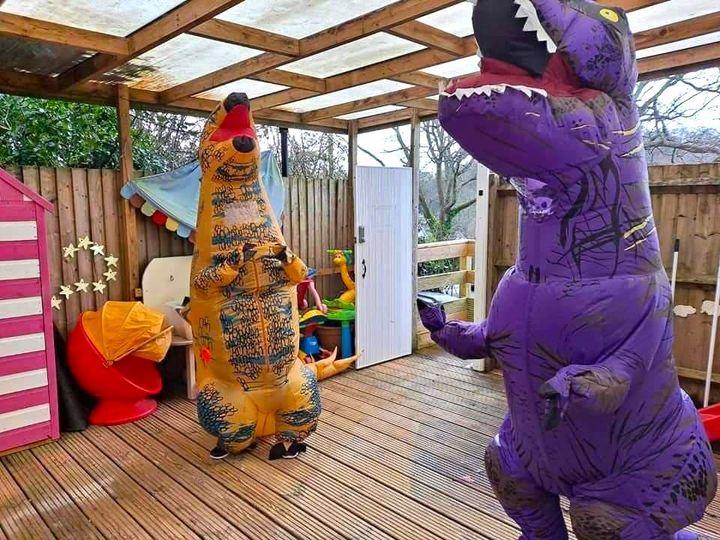 Janine Kindon (left) with a fellow dinosaur.