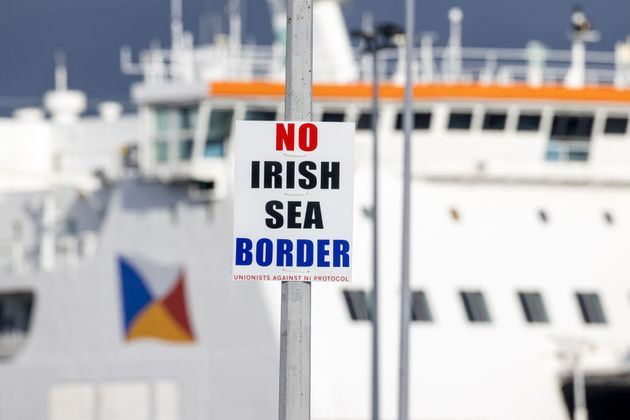 sign on a lamp post outside Larne Port with the word 'No Irish Sea