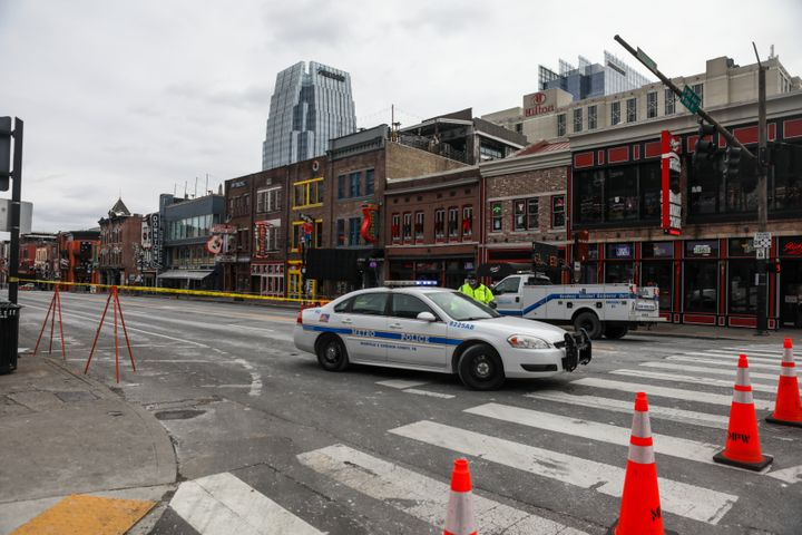 NASHVILLE, TN - DECEMBER 25: A police car blocks the street after an explosion on December 25, 2020 in Nashville, Tennessee.