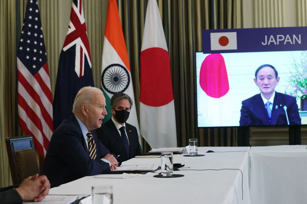 President Joe Biden, U.S. Secretary of State Anthony Blinken and Japanese Prime Minister Yoshihide Suga...