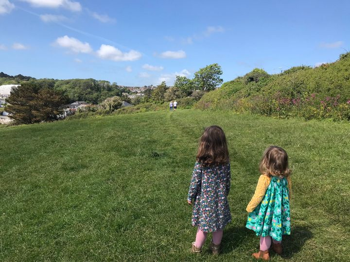 """This picture sums up the year to me and makes me feel very emotional. My dad turned 65 the day before my daughter turned two and we were finally allowed to meet outdoors. We met them in a field near where we live and this is my daughters watching their grandma and grandad walk away."" – Jess Collins, 37, Cornwall."