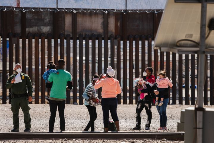 Border Patrol agents apprehend a group of migrants near downtown El Paso, Texas following the congressional border delegation