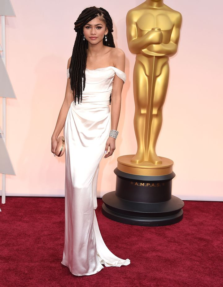 Zendaya wears faux locs and Vivienne Westwood couture at the 87th Academy Awards on Feb. 22, 2015.