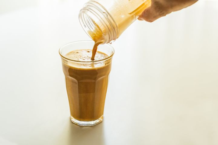 Bulletproof coffee gets its creamy color from butter that's been blended into the drink in a high-speed blender.