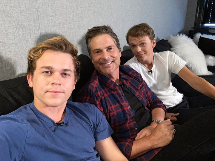 """Rob Lowe (middle) with his children, John Owen (left) and Matthew Edward on the unscripted reality TV series """"Celebrity Watch Party."""""""