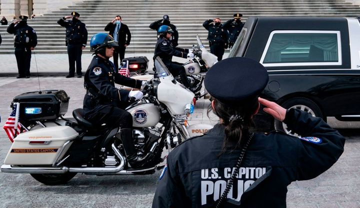 A hearse carrying the remains of U.S. Capitol Police Officer Brian Sicknick departs the Capitol on Feb. 3. Sicknick died afte