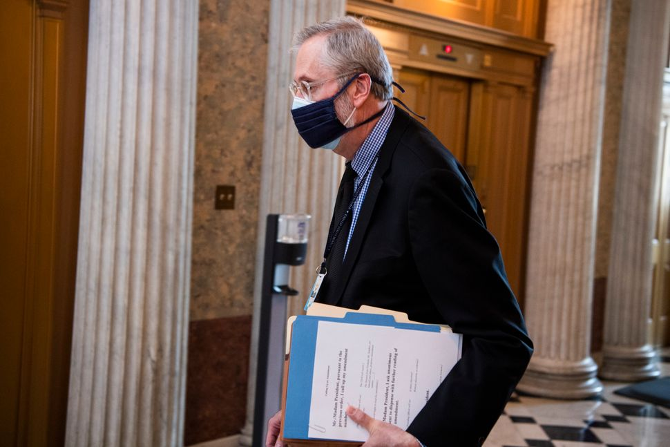Bill Dauster, Democrats' top lawyer on the Senate Budget Committee, is constructing arguments to help the party pass le
