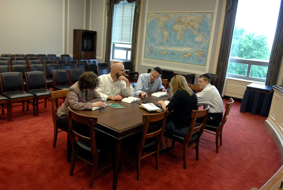From left: Sharon Beth Kristal, Tom Jones, Dauster, Charlotte Ivancic, and Adam Samuel Roth conduct a Torah study group in 20