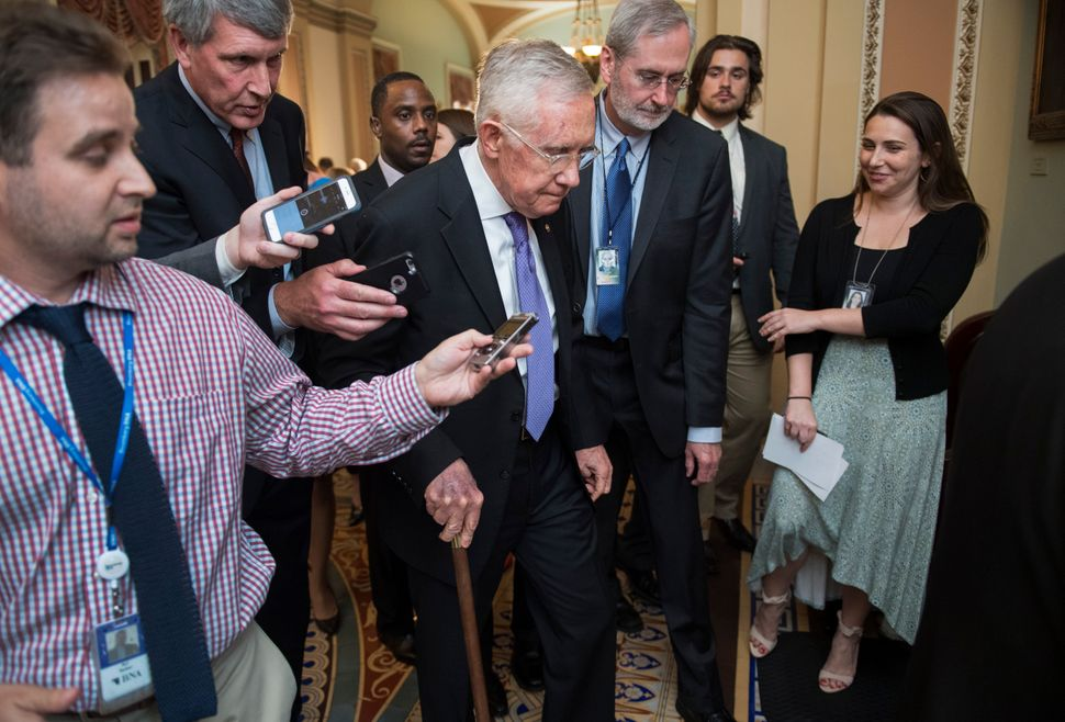 Dauster (center right) was deputy chief of staff to Senate Democratic leader Harry Reid (center) for six years and worked for
