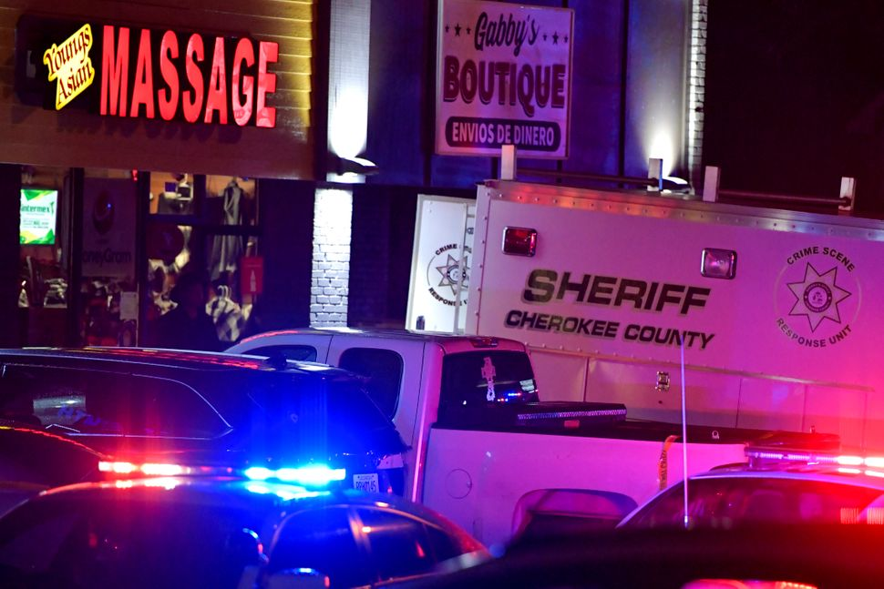 Authorities in Acworth, Georgia, investigate one of the fatal massage parlor shootings on March 16, 2021. Eight people were k